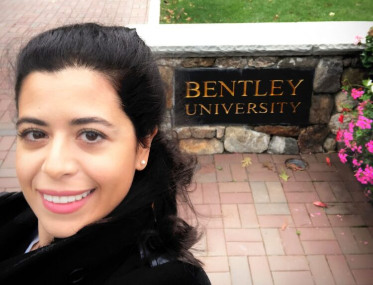 A selfie of Julide Etem in front of a Bradley University sign